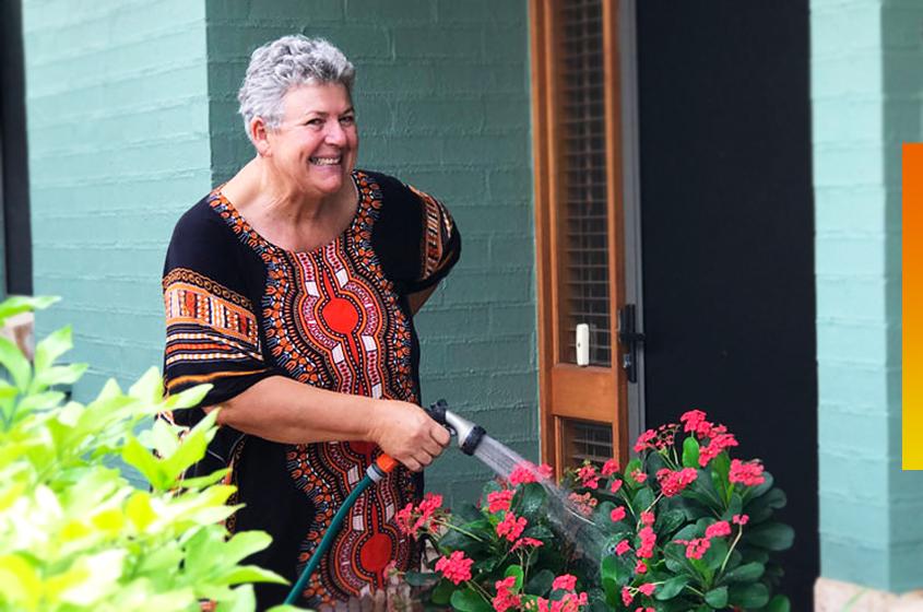 over-55-resident-watering-garden